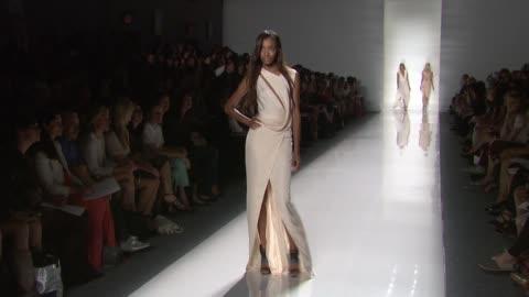 stockvideo's en b-roll-footage met models walk the runway wearing j. mendel spring 2012 during mercedes-benz fashion week spring 2012 at the j. mendel - spring 2012 mercedes-benz... - 2012