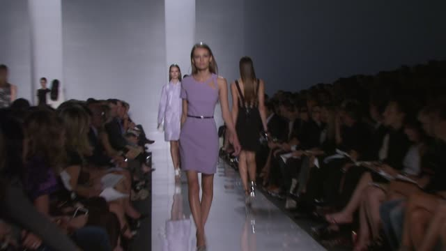 models walk the runway wearing michael kors spring 2010 collection at the mercedes-benz fashion week spring 2010 - michael kors at new york ny. - fashion collection stock videos & royalty-free footage