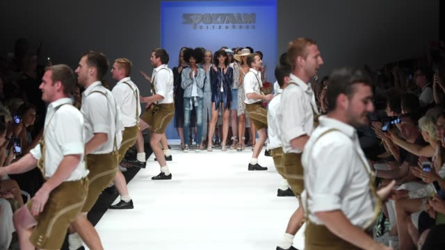 Models walk the runway while the group 'D'Gaflenza SchuahPlattla' perform at the Sportalm Kitzbuehel show during the Berlin Fashion Week...