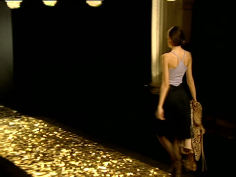 HA WS models walking up and down gold foil runway under row of chandeliers at B&C European Style fashion show/ ZI MS male and female models on runway/ Belgrade, Serbia
