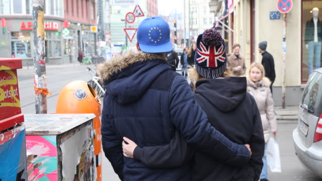 Models with Union Jack flag and The European Union Flag hats