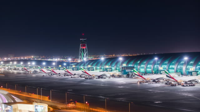 modern airport parking field busy at night - aircraft carrier stock videos & royalty-free footage