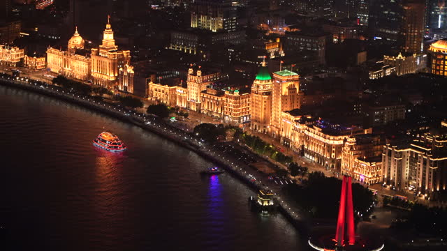 modern and history,aerial view of shanghai bund in night - china east asia stock videos & royalty-free footage