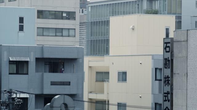 MS Modern apartment buildings in rain, Kyoto, Japan