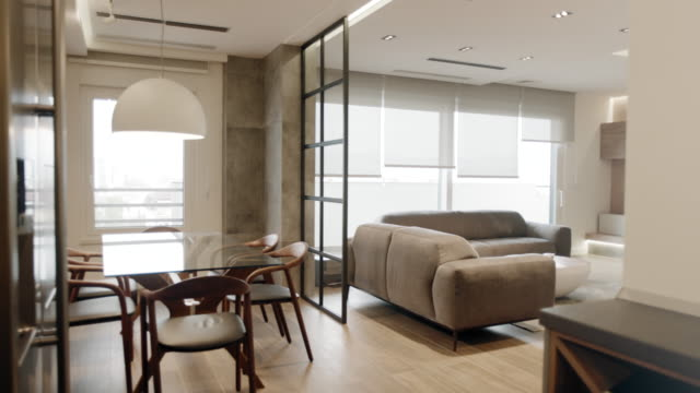 modern apartment dining room and living room - dining room stock videos & royalty-free footage