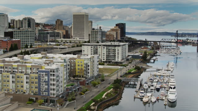 modern apartments on waterfront in downtown tacoma - drone shot - pierce county washington state stock videos & royalty-free footage