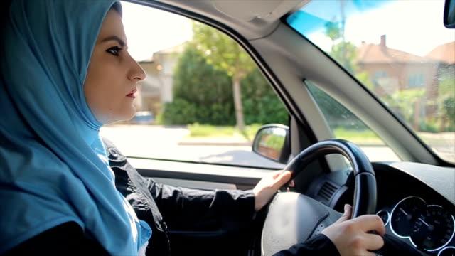 modern arab businesswoman driving a car - car interior stock videos & royalty-free footage