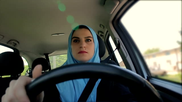 Modern Arab businesswoman driving a car