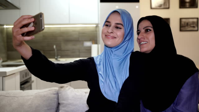 modern arab family-mother and daughter take a selfie on mobile phone - egypt stock videos & royalty-free footage