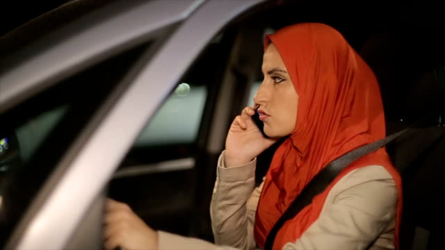 modern arab woman using mobile phone in the car - hijab stock videos and b-roll footage