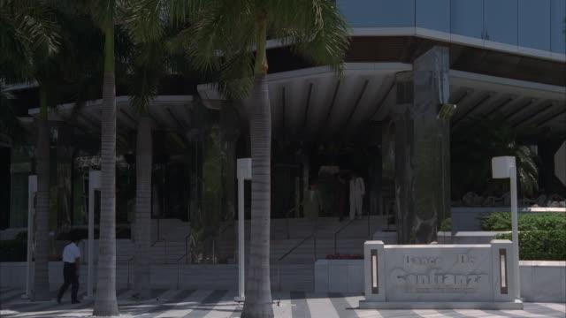 ms, tu modern bank building - fan palm tree stock videos & royalty-free footage