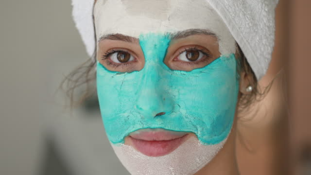 modern beauty model wearing a dried mask - wearing a towel stock videos & royalty-free footage