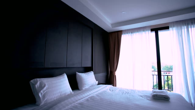 modern bedroom - bedclothes stock videos & royalty-free footage