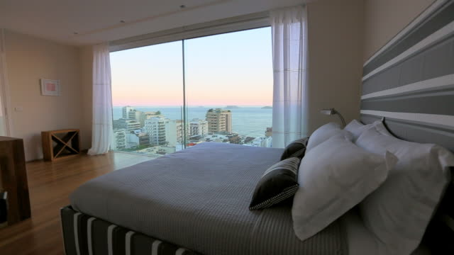 modern bedroom with view of rio de janeiro - hotel stock-videos und b-roll-filmmaterial