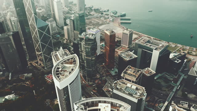 modern buildings by drone in hong kong - new business stock videos & royalty-free footage