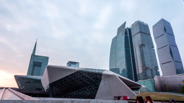 modern buildings exterior and walking pedestrians dusk to night,hyper lapse - dusk to night stock videos and b-roll footage