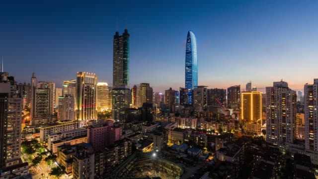 modern buildings exterior in shenzhen,time lapse - sunset to night time lapse stock videos & royalty-free footage