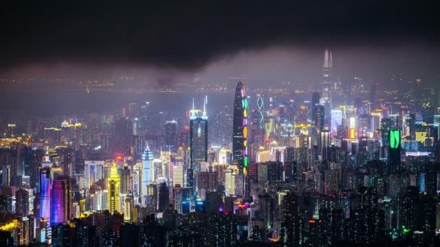 vídeos de stock e filmes b-roll de modern buildings exterior in shenzhen,time lapse - expansão urbana