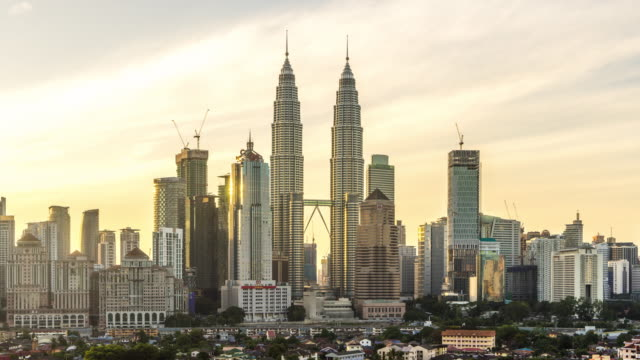 modern buildings in kuala lumpur at sunrise. time lapse - petronas twin towers stock videos and b-roll footage