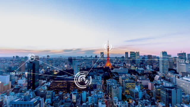 modern buildings in midtown of modern smart city in cloud sky. time lapse - tokyo japan stock videos and b-roll footage