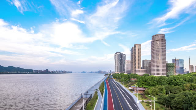 modern buildings near qiantangjiang river in hangzhou. timelapse day to night - hangzhou stock videos & royalty-free footage