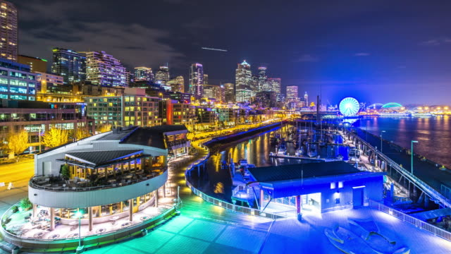 modern buildings near water at night in seattle. timelapse 4k - seattle stock videos & royalty-free footage