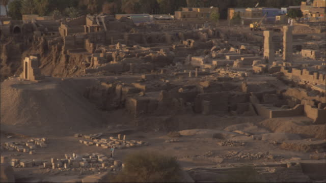 modern buildings surround ancient ruins. - old ruin stock videos & royalty-free footage