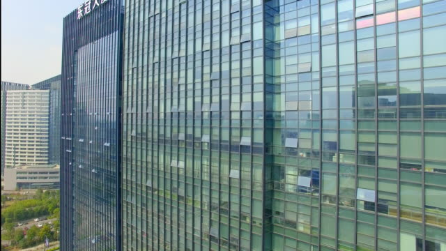 modern buildings with glass wall in hangzhou 4k - wall building feature stock videos & royalty-free footage