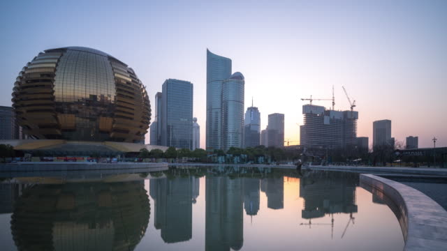 modern business building near water in hangzhou new city. timelapse 4k hyperlapse