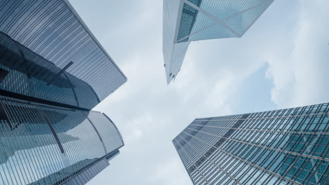 modern business buildings with blue sky, shot in hong kong, asia - sezione superiore video stock e b–roll