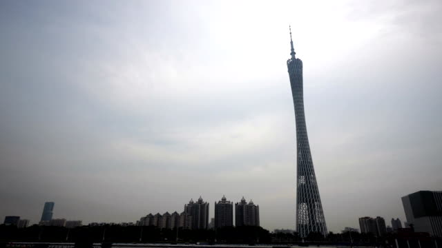 modern city center in guangzhou, with the famous canton tower in the bakground - tower stock videos & royalty-free footage
