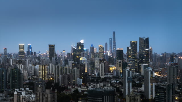 tl ms ha modern city downtown skyline from dusk to night / shanghai, china - dusk to night stock videos & royalty-free footage