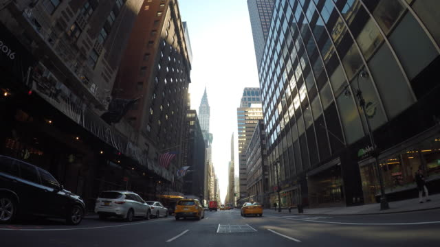 modern city shown from a car's point of view. skyscrapers, banking district and business area. - car point of view stock videos & royalty-free footage