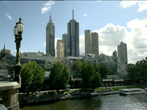 Modern city skyline along bank of River Yarra Melbourne
