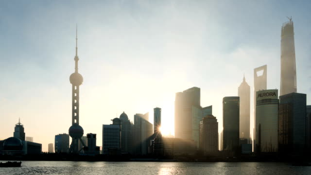 modern cityscape and skyline of Shanghai during sunrise,timelapse..