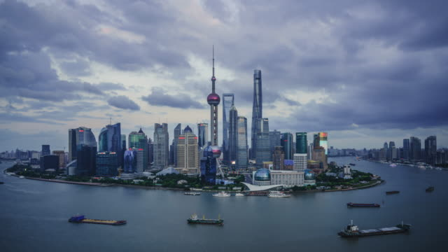 modern cityscape and skyline of shanghai during sunset,timelapse - shanghai stock videos & royalty-free footage