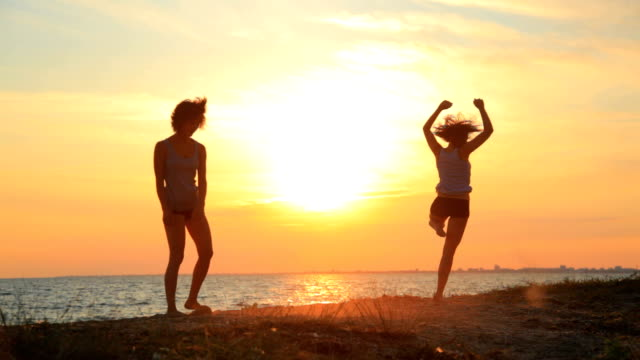 modern contemporary dance young gymnast women at sunset beach - modern dancing stock videos & royalty-free footage