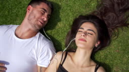 Modern couple listening music while absorbs Argentinian sun