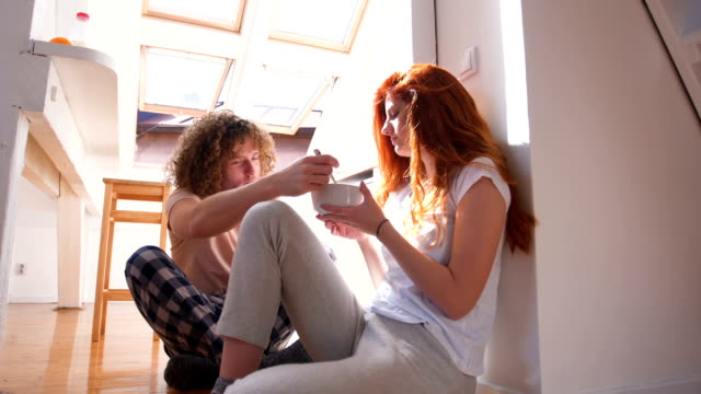 modern couple sharing the breakfast - 25 29 ans stock videos & royalty-free footage