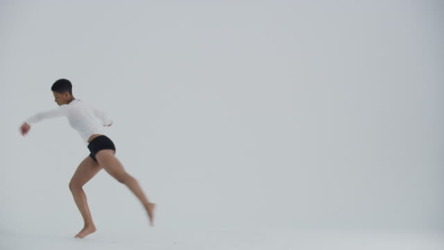 modern dancer dancing in studio, jumping and flipping mid air - white background stock videos & royalty-free footage
