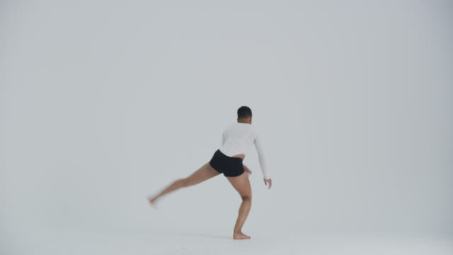 modern dancer dancing in studio, jumping and flipping towards camera - modern dancing stock videos & royalty-free footage
