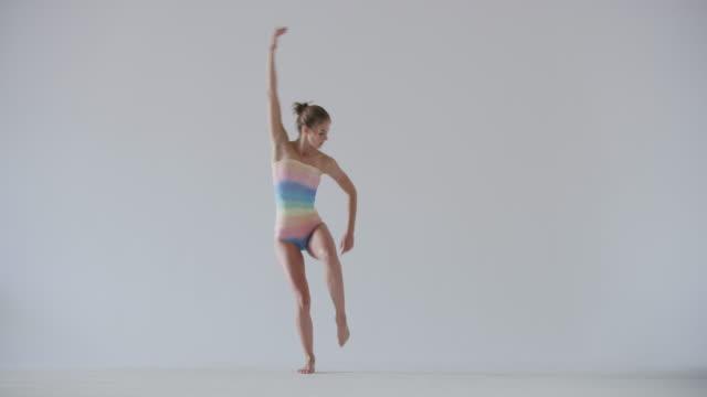 modern dancer dancing in studio wearing rainbow leotard - leotard stock videos & royalty-free footage