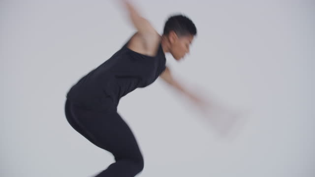 modern dancer woman back flipping and dancing in studio dressed in black - black hair stock videos & royalty-free footage