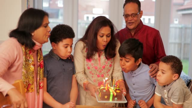 modern day muslim family blowing out the candles - social gathering stock videos & royalty-free footage