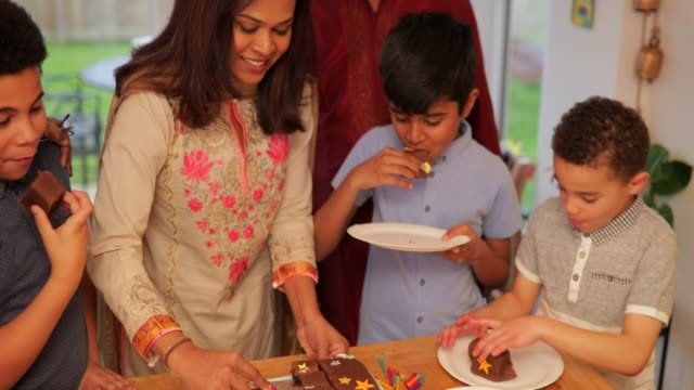 modern day muslim family cutting the birthday cake - celebration stock videos & royalty-free footage