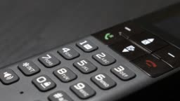 Modern design landline phone on table dials and screen slow tilt 4K 2160p 30fps UltraHD video - Wireless telephone turning off display energy saving 4K 3840X2160 UHD footage
