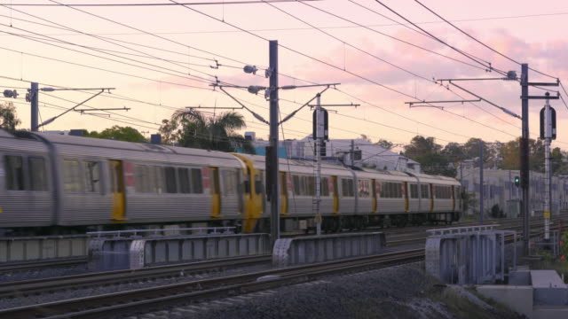 A modern electric passenger train at sunset