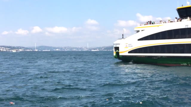 A modern ferry in front of the Galata Bridge in Istanbul, Turkey