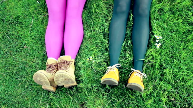 modern footwear in colourful legs against vivid background - pair stock videos & royalty-free footage