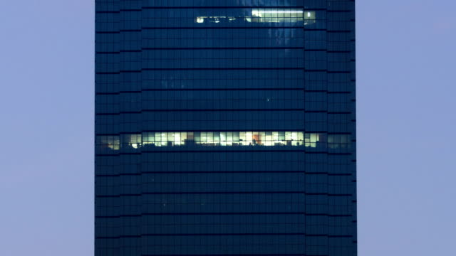 modern glass building at night - working overtime stock videos & royalty-free footage